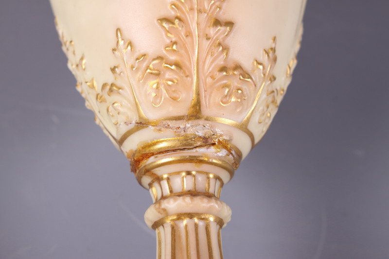 Lot 45 - A Royal Worcester blush ivory two-handled cylindrical vase, decorated with bouquets of flowers (a/
