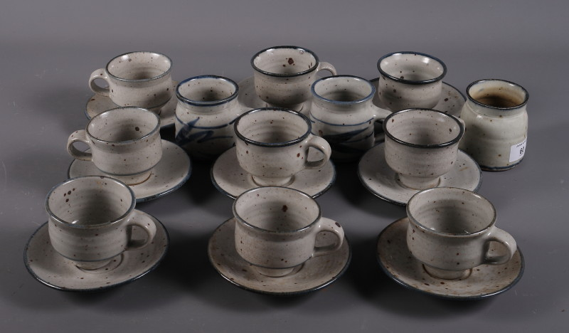 Lot 3 - Colin Kellam studio pottery: a set of nine cups and saucers