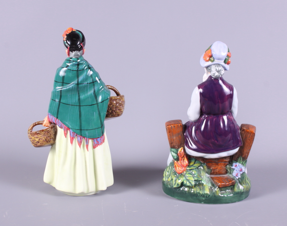 "Lot 20 - Two Royal Doulton porcelain figures, ""Rest Awhile"" HN2278 and ""The Orange Lady"" HN1953"