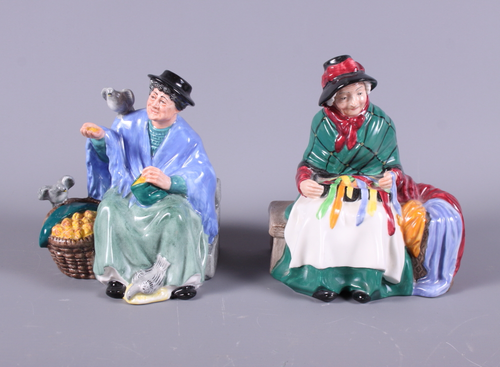 """Lot 21 - Two Royal Doulton porcelain figures, """"Tuppence a Bag"""" HN2320, and """"Silks and Ribbons"""" HN2017"""