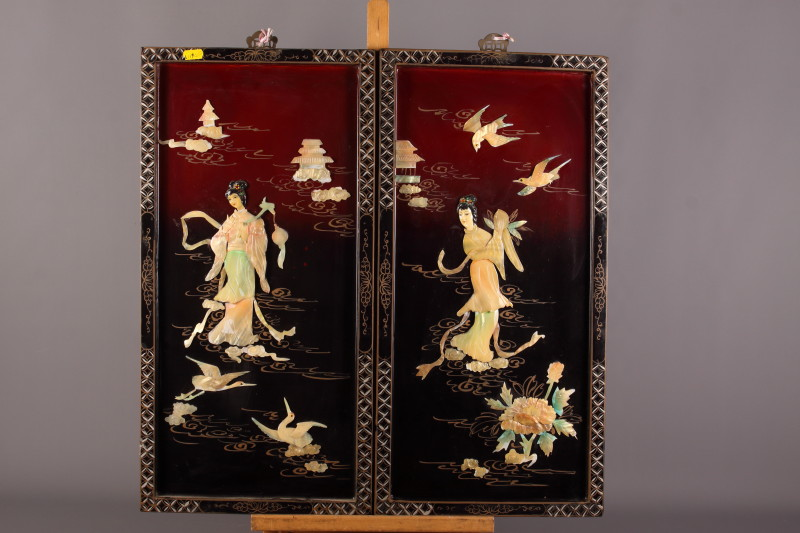 Lot 56 - A set of four early 20th century Japanese hanging panels, each decorated with applied mother-of-