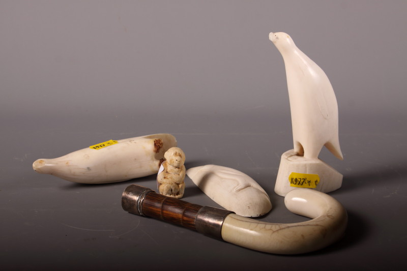 Lot 55 - A collection of various sperm whale scrimshaw carvings a carved ivory cane handle with silver collar