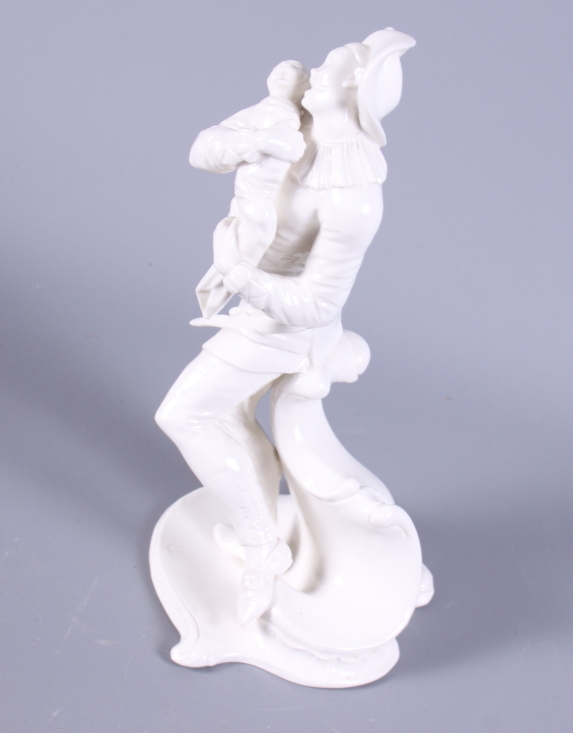 Lot 30 - A 19th century, possibly Meissen, blanc-de-chine porcelain figure of a standing man holding a baby