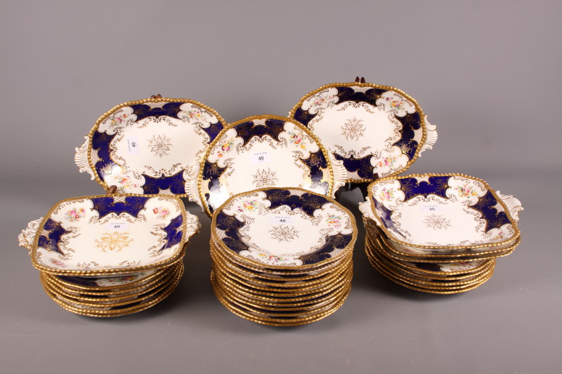 Lot 40 - A late 19th century Coalport porcelain part dessert service with alternate panels of flowers and