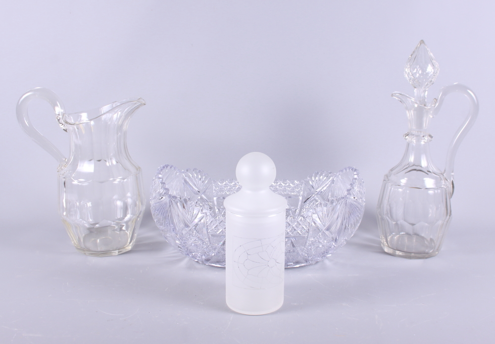 Lot 36 - A large cut crystal clear-glass bowl, a matching jug and ewer set and a frosted glass flask with