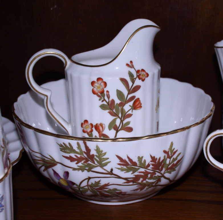 Lot 16 - A Royal Worcester blush ivory porcelain fluted combination service in the Aesthetic style, decorated