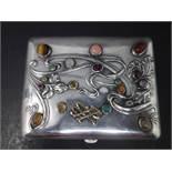 A 19th century Russian silver cigarette case, set with semi-precious and precious stones, to include