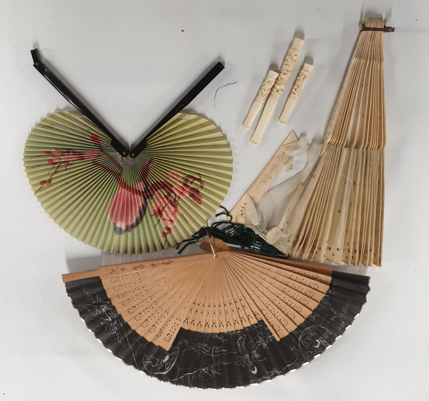 Lot 495 - A group of vintage Fans along with three Cherutes.