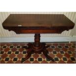 A Regency Rosewood Foldover Card Table with centre shaft two scissors movement base on brass toe