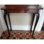 A 19th Century Rosewood Side Table with cabriole supports.