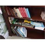 A quantity of Books in bookcase.