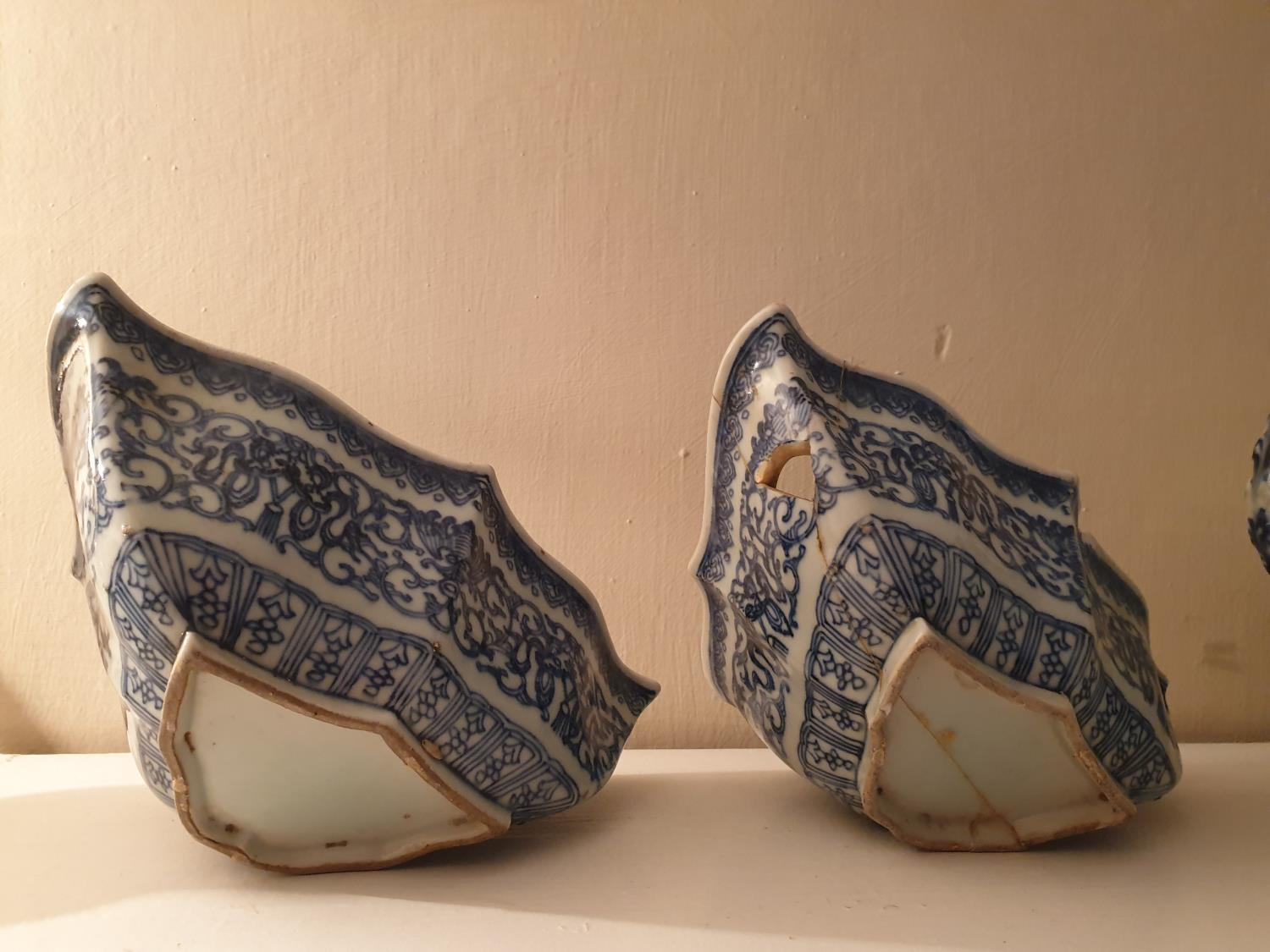 Lot 58 - A pair of Blue and White Oriental Bowls in triangular shape (1 AF) 20 x 13cm. along with a large