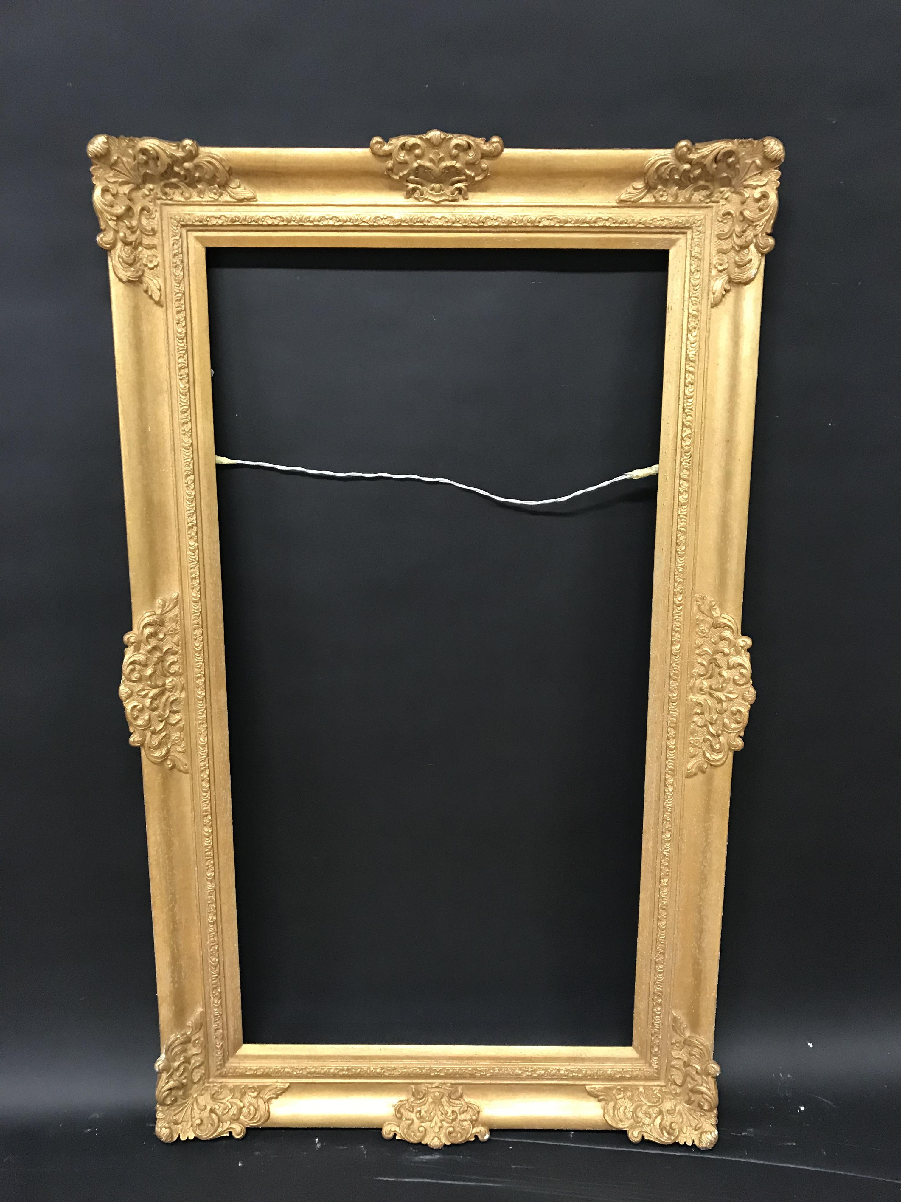 """Lot 13 - 20th Century English School. A Gilt Frame with Swept Centres and Corners, 42"""" x 22"""" (rebate)."""