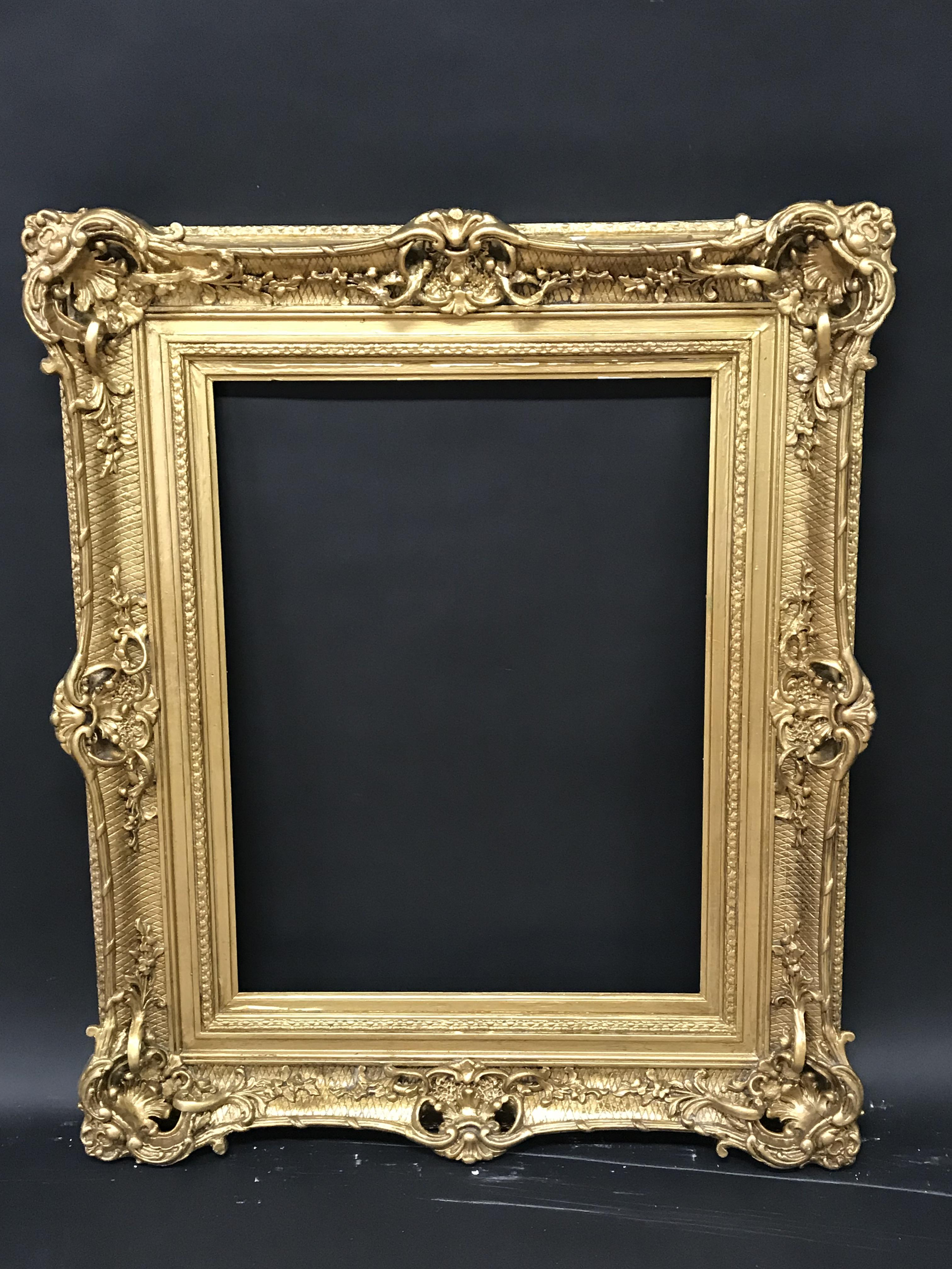 Lot 17 - 19th Century English School. A Gilt Composition Frame, with Swept and Pierced Centres and Corners,