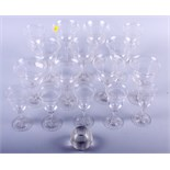 A part suite of engraved glasses and a spherical glass match striker