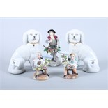 A pair of Staffordshire design poodles, a Sitzendorf porcelain figure of a flower seller and a