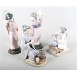 A group of four Spanish porcelain figures, including two matt finish figures, a Casades figure, a