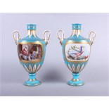 A pair of early 19th century Sevres porcelain oviform vases with swan neck handles with figured