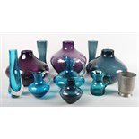 A collection of assorted Geoffrey Baxter Whitefriars blue glass vases and jugs, etc