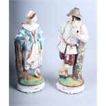 """A pair of Continental bisque porcelain figures in Swiss national dress, 15"""" high (slight damages)"""