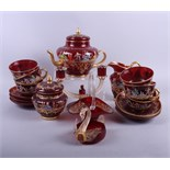 A Continental ruby glass part teaset with enamelled decoration of 18th century figures and gilt