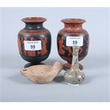"""A pair of Greek red figure vases, 4 1/2"""" high, a Roman ceramic oil lamp and a Roman glass vial"""