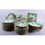 A Worcester Flight Barr and Barr part dessert service, decorated green and gilt borders with hand