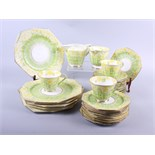 A Paragon part teaset, decorated primroses, and assorted decorative plates