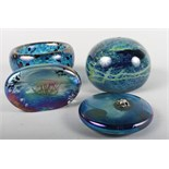 Two John Ditchfield Glasform paperweights, one decorated frog on a lily pad, and two other pieces of