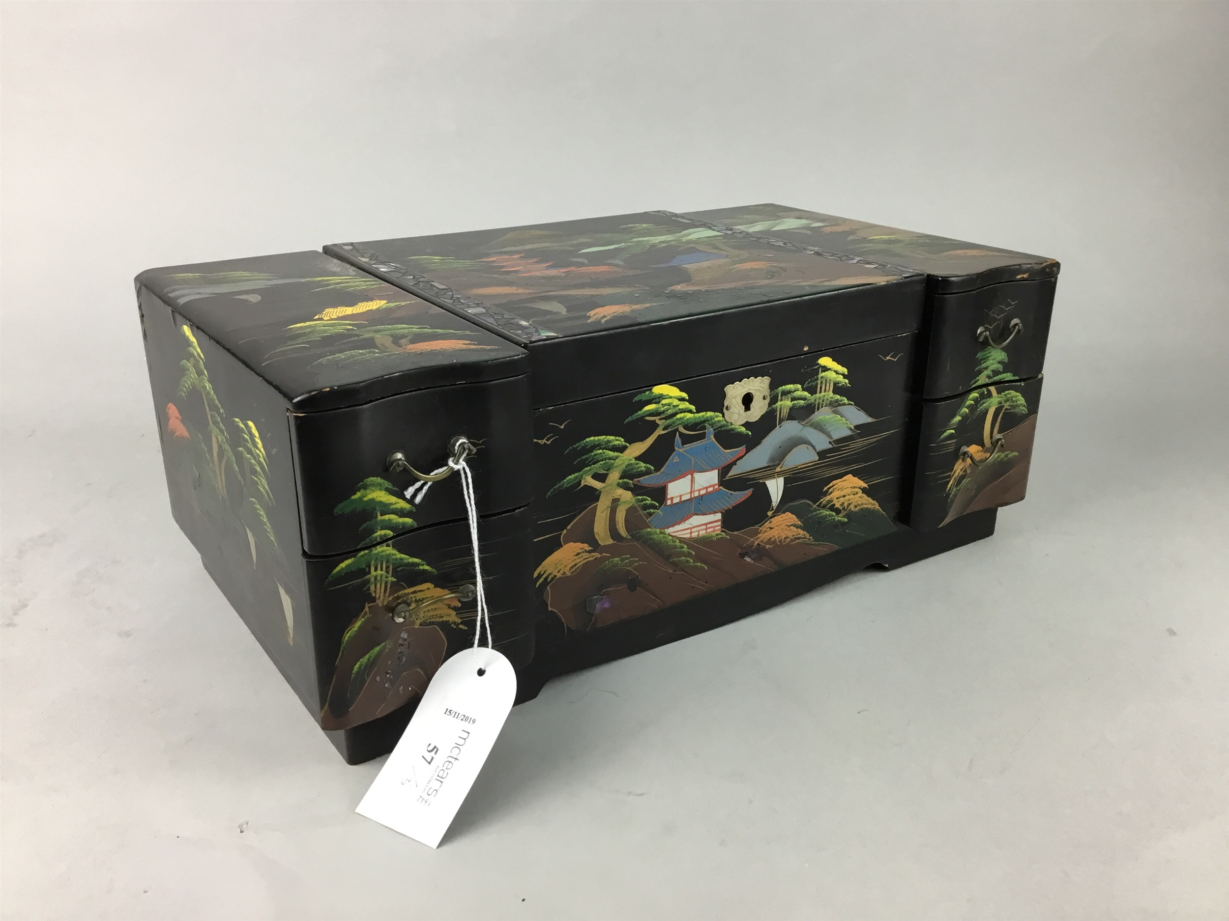 A LACQUERED AND PAINTED JEWELLERY BOX AND TWO OTHER BOXES