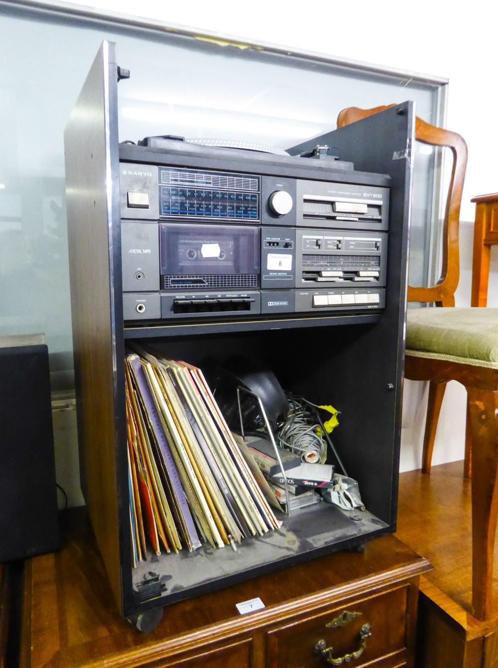 Lot 8 - A STACKING STEREO SYSTEM BY SANYO, WITH GLASS FRONTED CABINET INCLUDING RECORD TURNTABLE AND SOME LP