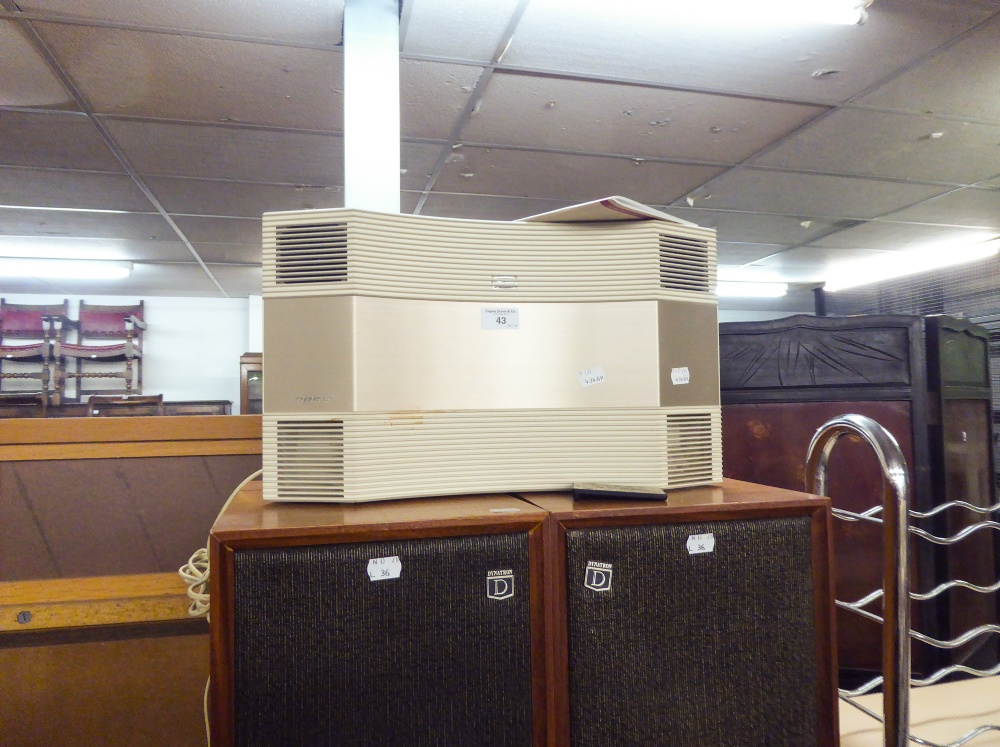 Lot 43 - A BOSE CD PLAYER AND RADIO