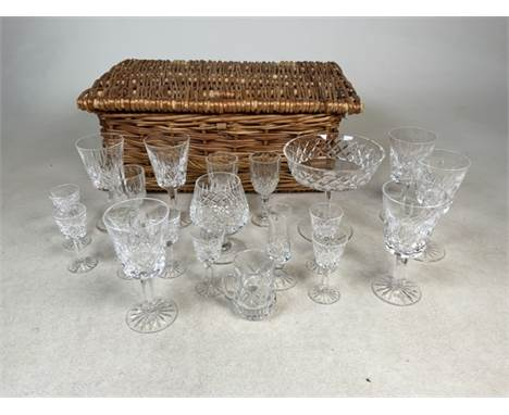 A selection of Waterford Crystal glassware to include liquor, wine, champagne and other glasses together with a wicker basket