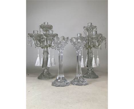 A pair of lead crystal candle sticks Height: 25cm, together with pair of early twentieth century glass drop lustre candelabra