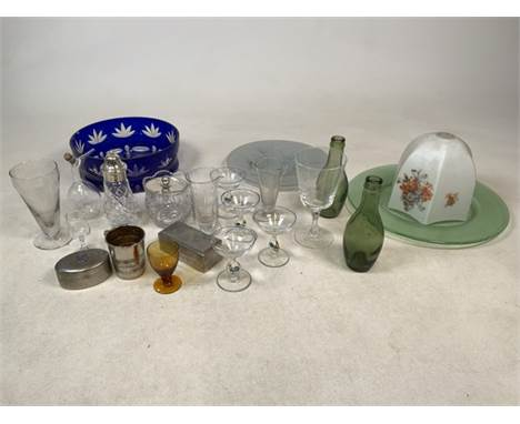 A selection of glassware to include blue glass bowl, green glass plate, green glass bottles and other items