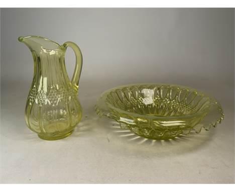 A Uranium yellow glass jug and punch bowl. Jug: H: 31cm. Punch bowl: W:40cm H: 12cm
