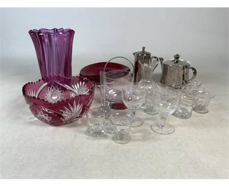 An assortment of glassware to include cranberry glass vase and bowl. A selection of wine and liquor glasses plus Royal Worces