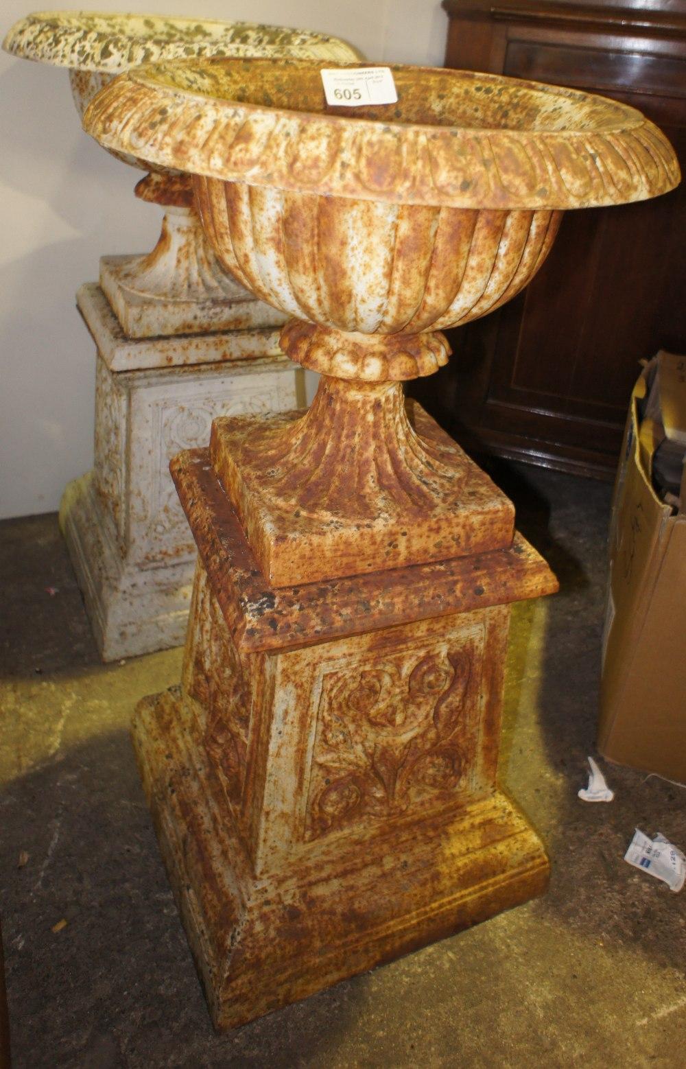 Lot 605 - NV- A pair of decorative classical design cast iron garden urns