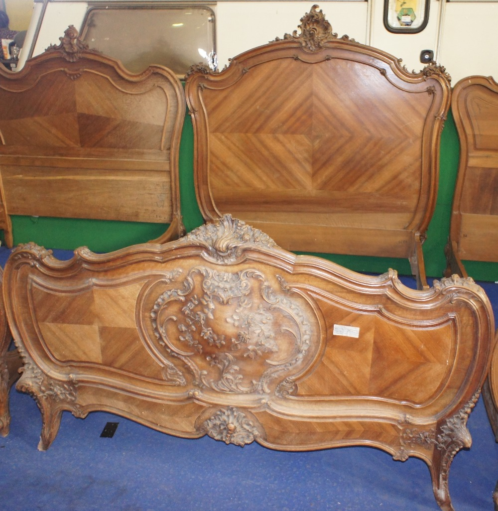 Lot 626 - NV- A decorative carved mahogany French style double bed
