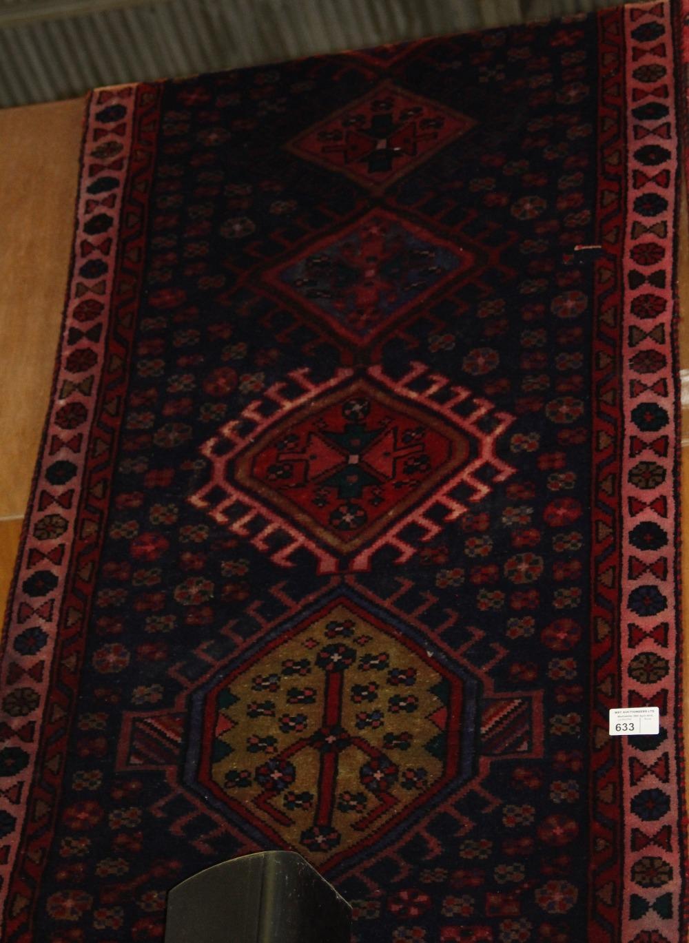 Lot 633 - NV- a hand woven blue ground Persian runner. Approx. 310 X 100cm