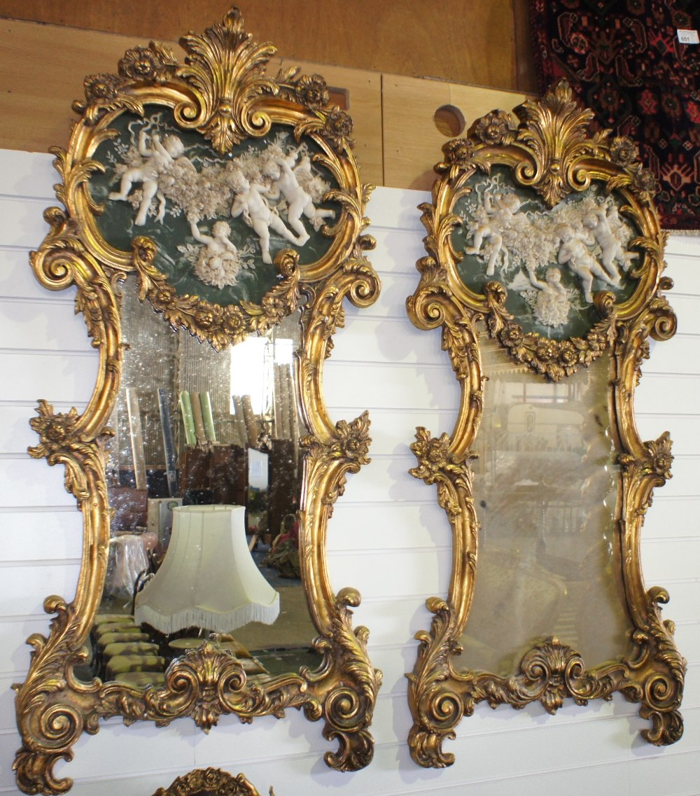 Lot 615 - NV- A pair of large decorative wall mirrors with gilt work frames of foliate and scroll work