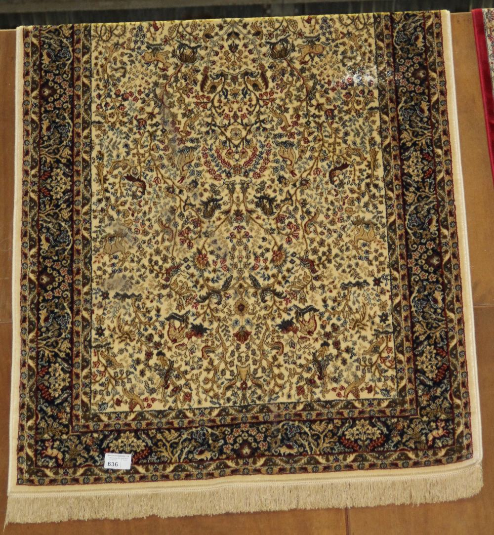 Lot 636 - NV- an ivory ground carpet, tree of life design. Approx. 6' X'4'