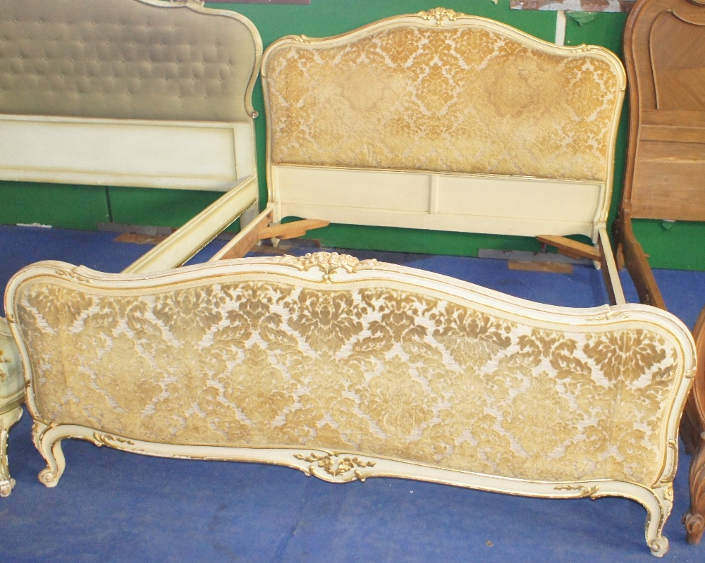 Lot 628 - NV- A decorative white and gilt painted double bed with an upholstered head and foot