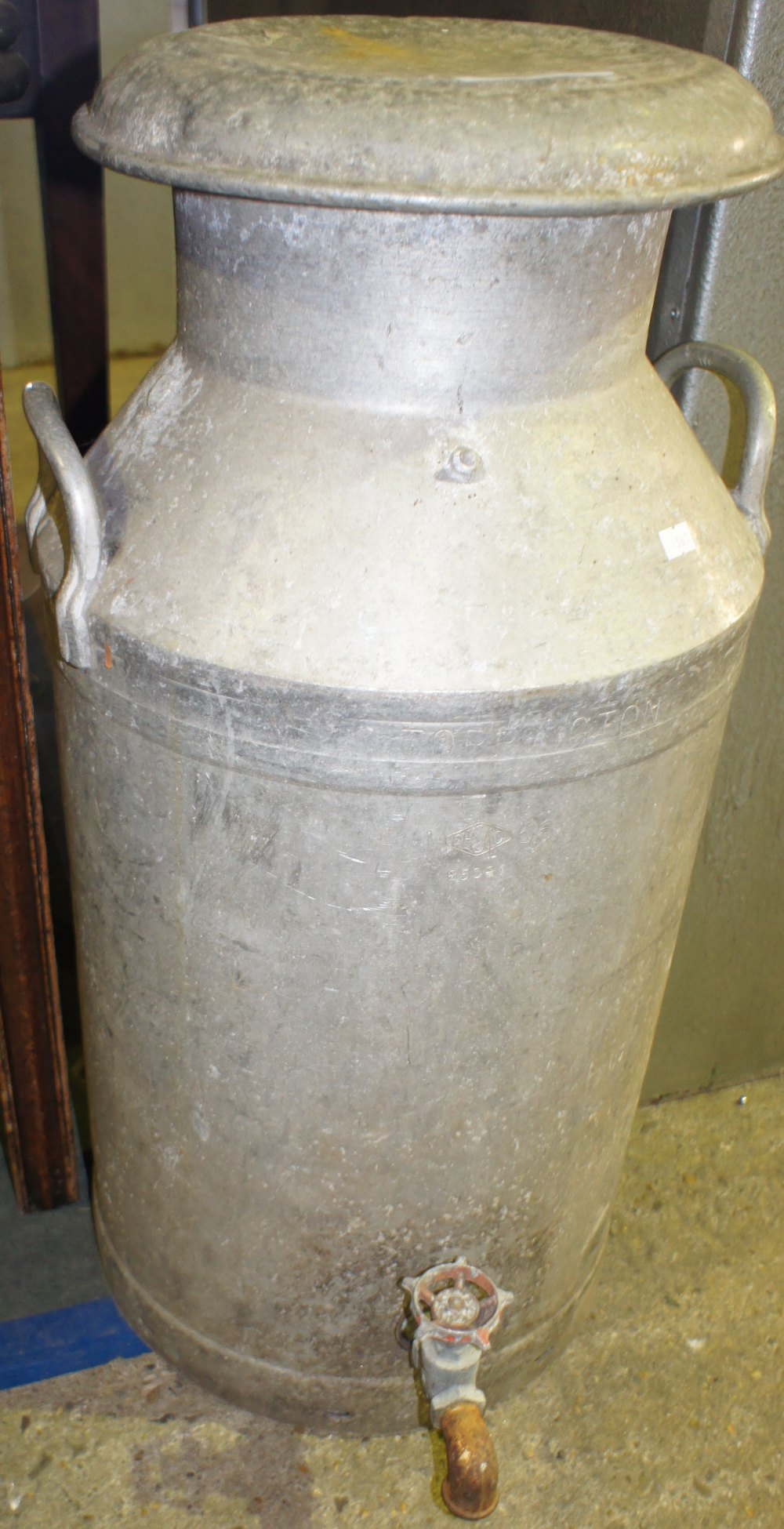 Lot 653 - NV- an old Panamanian milk churn with an added tap