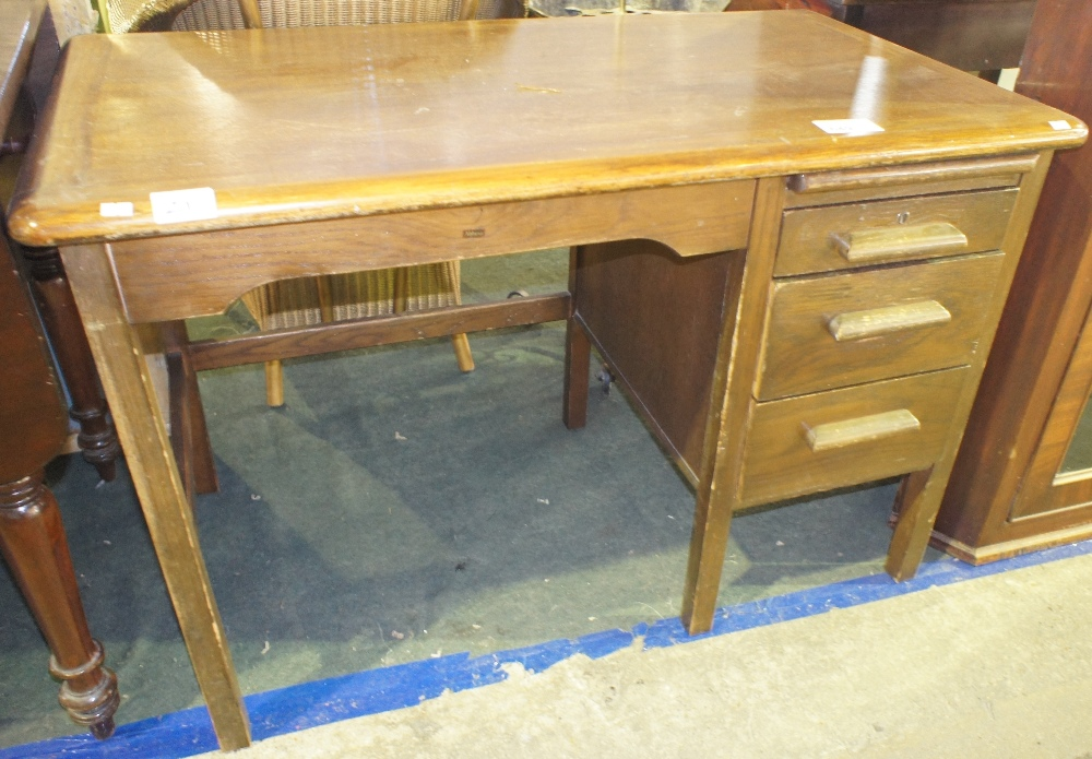 Lot 649 - NV- a child's dark wood single pedestal desk