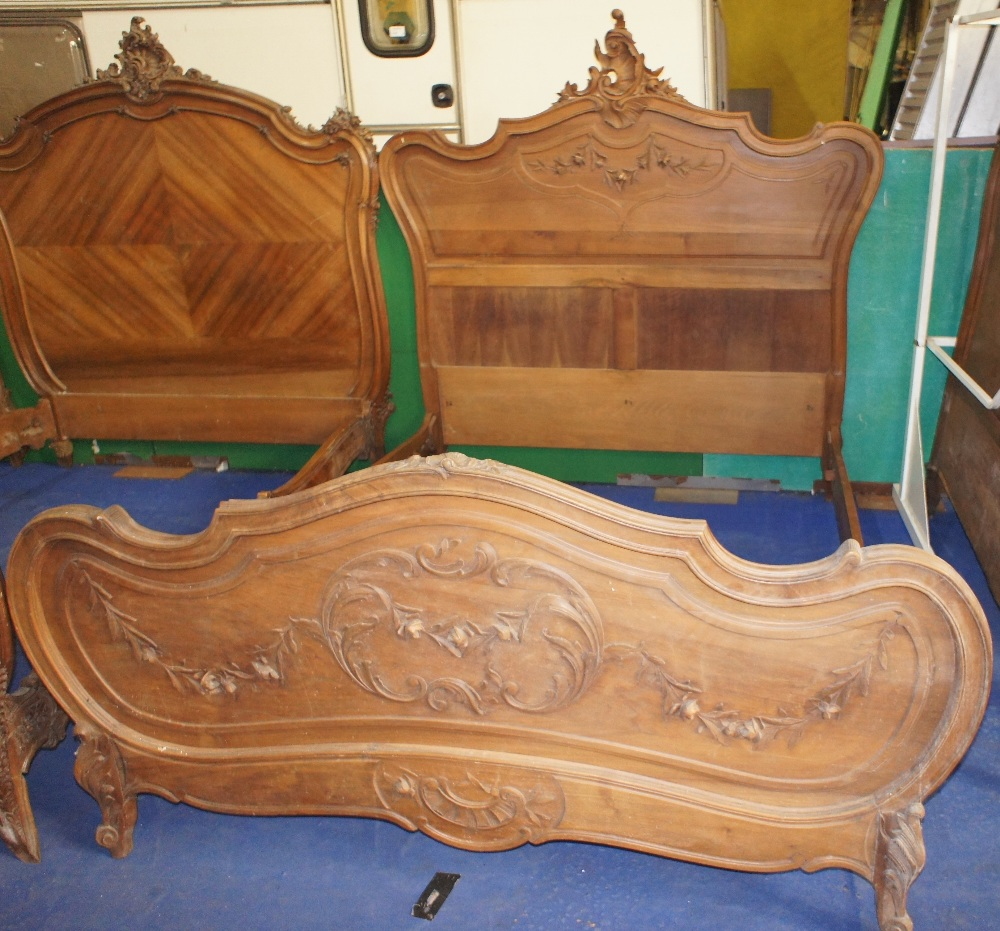 Lot 625 - NV- A decorative carved mahogany French style double bed