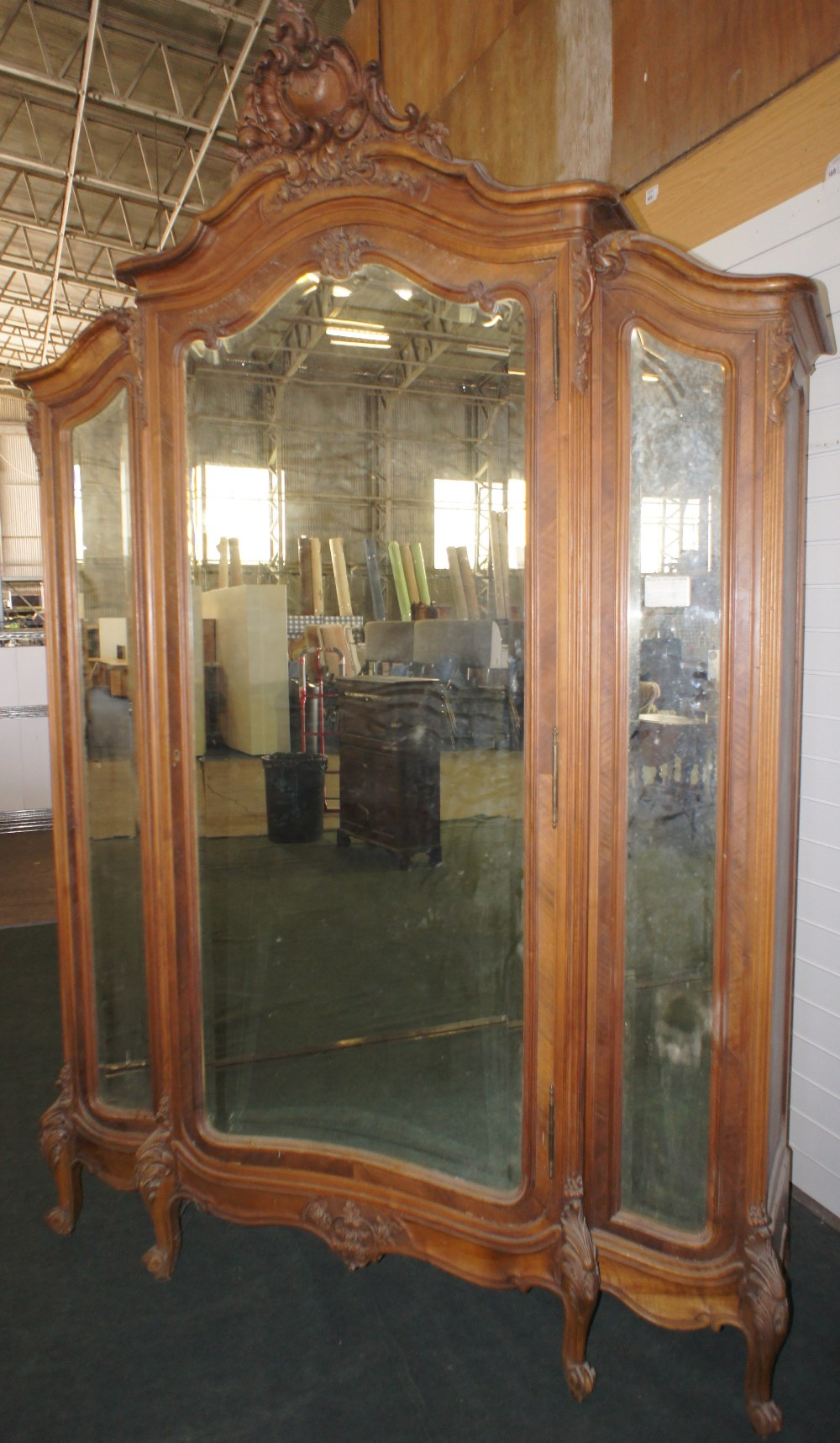 Lot 609 - NV- A highly decorative carved mahogany French style armoire/wardrobe with a mirrored door and two