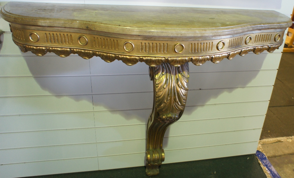 Lot 623 - NV- A decorative gilt work consul table with one support and a mottled shaped marble top