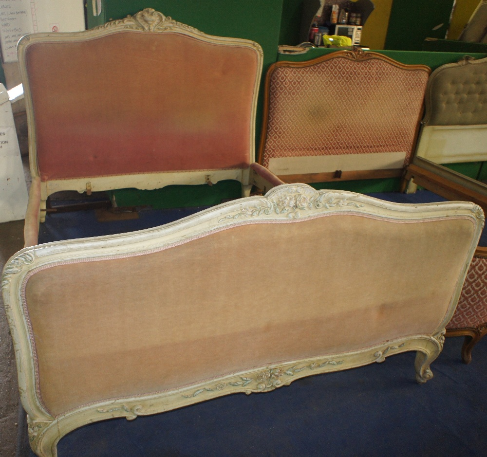 Lot 631 - NV- A white painted French style double bed with a pink upholstered head and foot