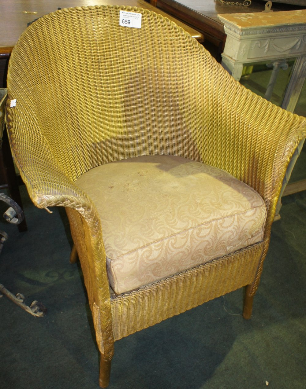 Lot 659 - NV- a gilt painted Lloyd Loom conservatory chair